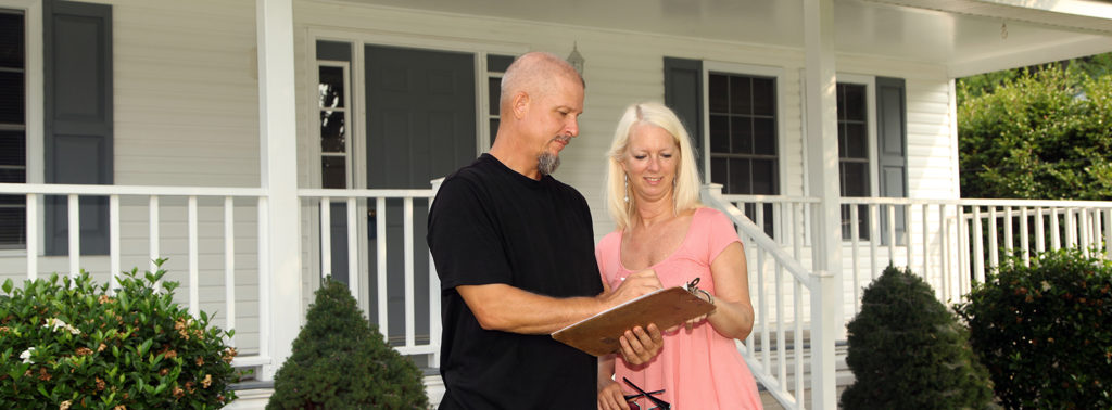 Homeowner signing contract